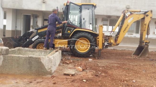 شاحنة في المغرب CATERPILLAR 428c - 270693