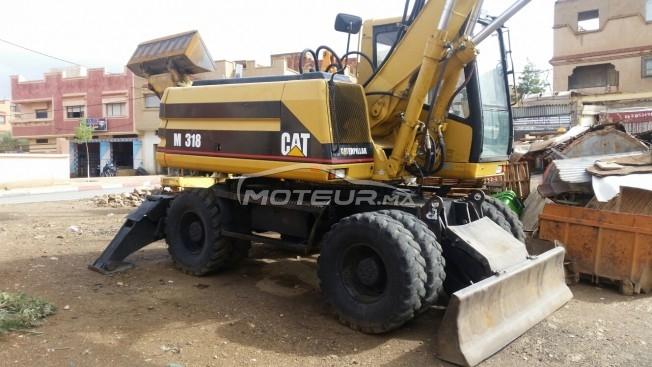 شاحنة في المغرب CATERPILLAR M318 - 246428